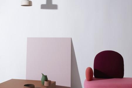 """Meld"" pendant lamp by Noidoi; ""Between"" armchair by Sara Wright Polmar; ""Three Cities: Deconstructed"" ceramic serving tile by Vera & Kyte; ""Stilleben"" clay bowls by Ann Krisin Einarsen; ""Pour"" cast-porcelain pitcher by günzler.polmar (styled by Kråkvik & D'Orazio; photo by Siren Lauvdal)"