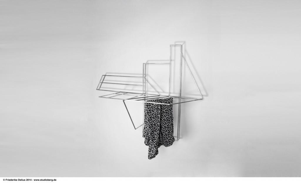 Studio Berg (D), Foldwork, wall piece/cloth rack in stainless steel, cm 95H x 134W x 44D, 2013. ©Studio Berg