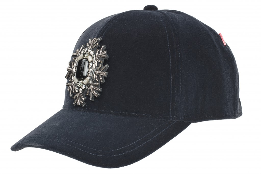 A Made in Italy baseball cap embellished with a gilded brooch
