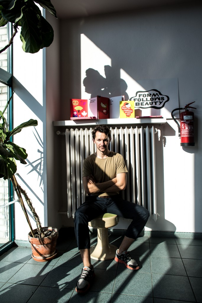 The graphic designer in his Warsaw co-working space studio