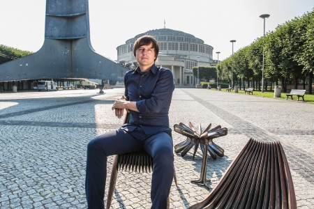 The designer sits with his Steel in Rotation collection in front of Wroclaw's Spire erected for the Exhibition of the Regained Territories in 1948