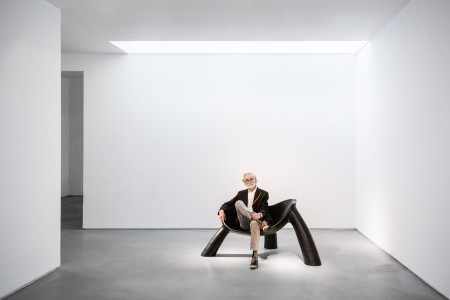 Portrait of Wendell Castle seated on Long Night (2011) Photo by Adrien Millot, courtesy of Friedman Benda and the artist