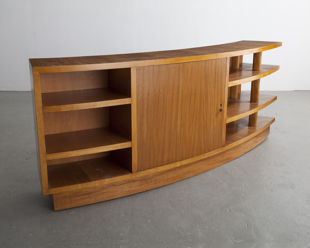 Curved credenza in pau marfim (ivory wood). Early design by Joaquim Tenreiro, Brazil, 1940s.
