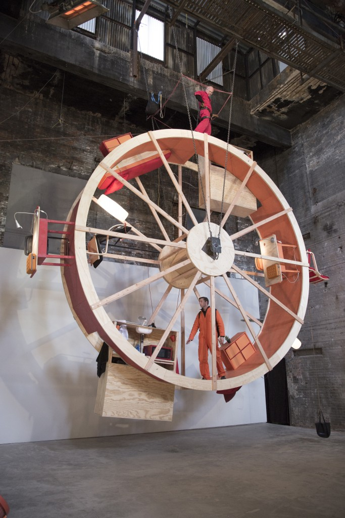 "Alex Schweder's ""In Orbit"". 2013, Wood, Steel, Furniture, 10 Day performance, 20'-0"" x 8'-0"" x 30'-0"". Photo: Double Cyclops"