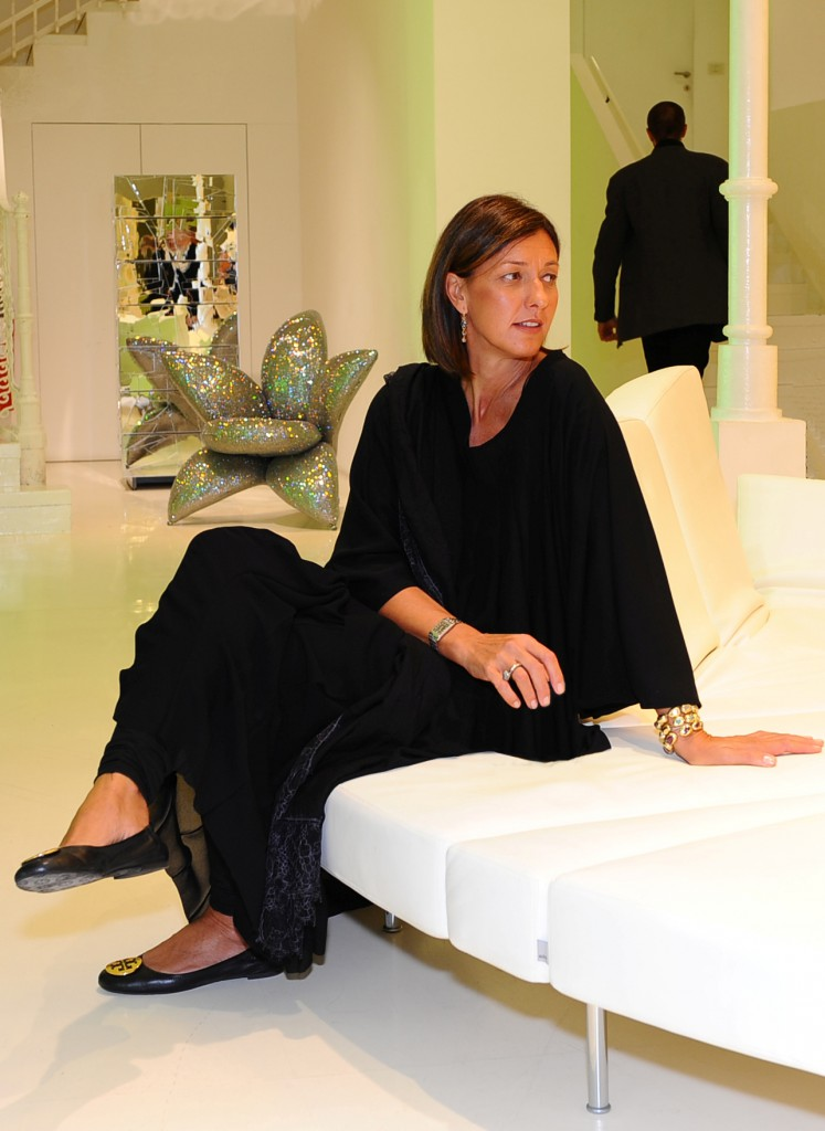 Monica Mazzei on a Flap sofa designed by Binfaré and, in front of the Getsuen chair by Masanori Umeda with Swarovski
