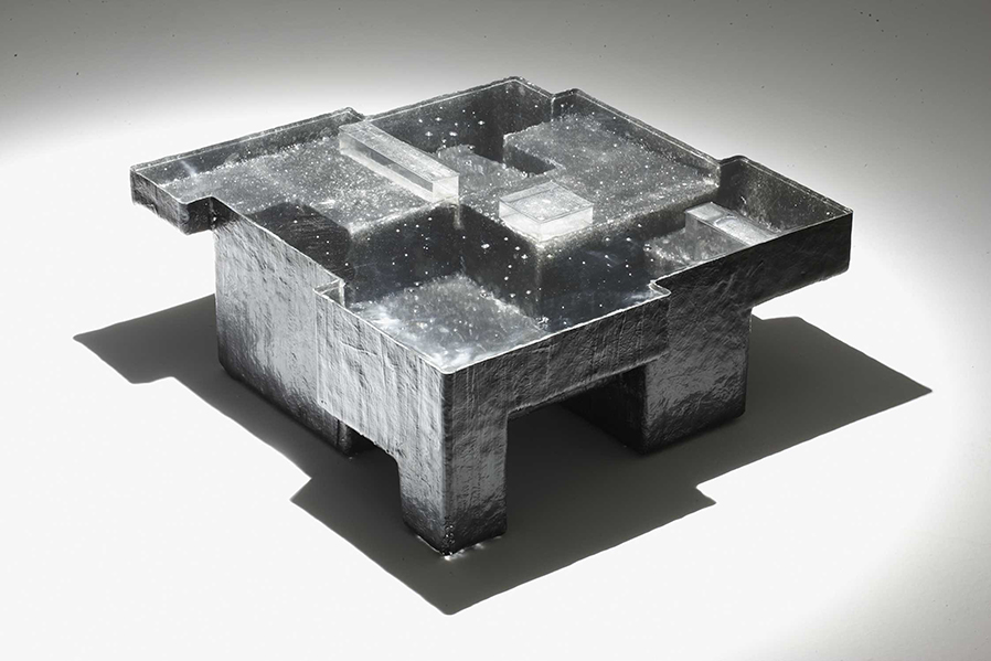 Black Resin Fossil coffee table, Photo courtesy of Amman//Gallery