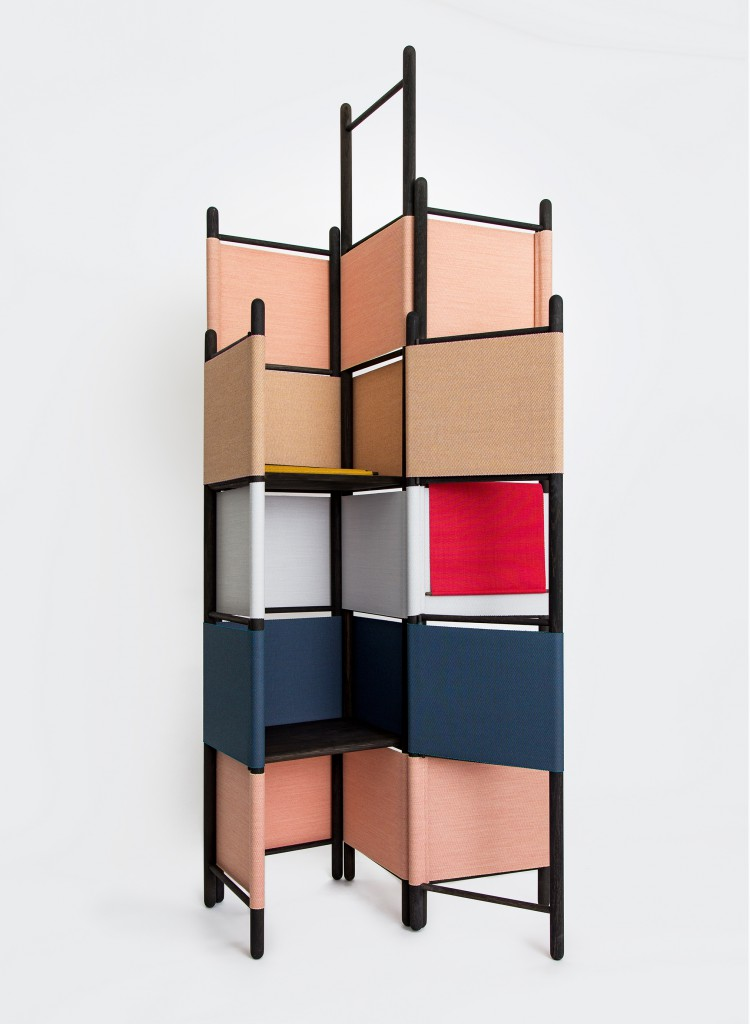 Loom Bound (2016) by Rive Roshan. Fabric is used as a hinge and a joining element for the oak components in this partition system.