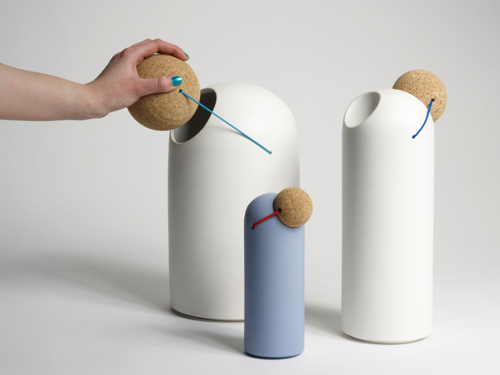 Clown Nose (2010) by Tomas Kral. A coloured elastic thread connects this ceramic storage vessel with its spherical cork lid.