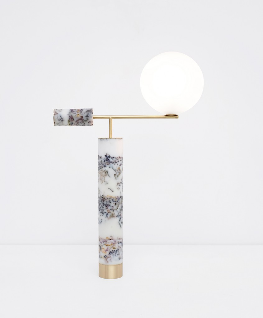 Flora Lamp by Marcin Rusak, suspends flowers in black resin to create a marble-like material.