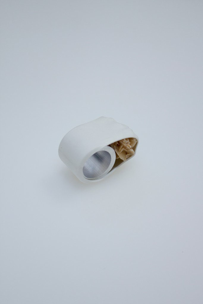 Unwilling Connection (2016) by Marina Stanimirovic. Ring made by binding a sand rose to aluminium with heat shrink tubing.