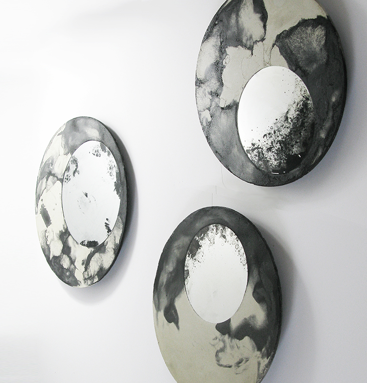 Taeg Nishimoto (Texas, US), Liquid mirrors, wall installation of cast pigmented concrete disks playing with optical textures, 35-42 or 50 cm diam., 4 cm high, 3,4 kg, unique pieces, actual concrete disk is 7mm thick, and there is a swivel and hanging mechanism attached in the back.
