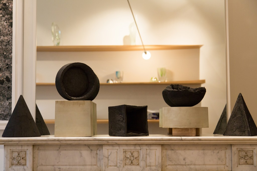 Installation view of From Below Pyramid, Hemisphere and Cube by Philipp Weber. Coke ( 99% carbon), destructive distillation, ca. 15h x 25 cm diameter, 2016, ed. 1/8