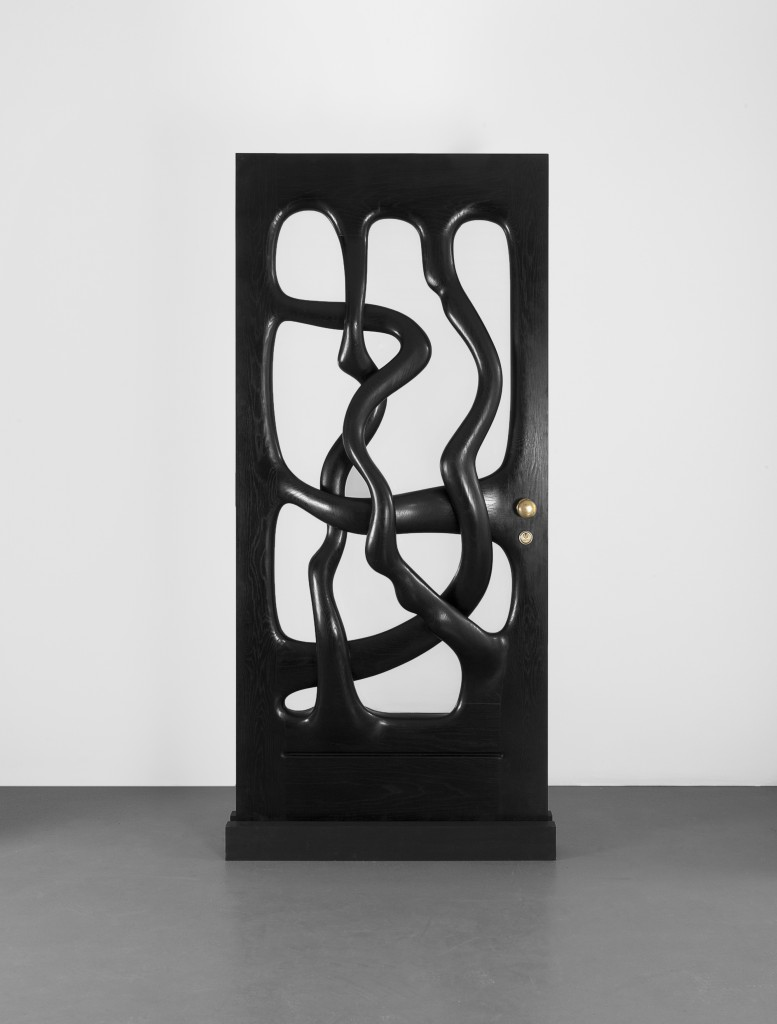 A Sculpted Door (1976), maple, ebonised maple, glass, brass fitments.