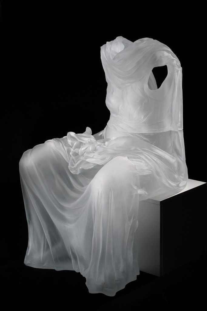 Karen LaMonte, Seated Dress Impression with Drapery, 2007 The dresses of Karen LaMonte conjure up absent bodies as they spring forth like apparitions or spectres, accentuated by the milky, opalescent glass finish. They enclose imprints of absent bodies, as though they had stolen them: the trace of a navel, the curve of a bosom or knees and the lines of a back. LaMonte's work was shown in France for the first time at MusVerre's 2010 solo exhibition Réflexions Féminines [Feminine Reflections].