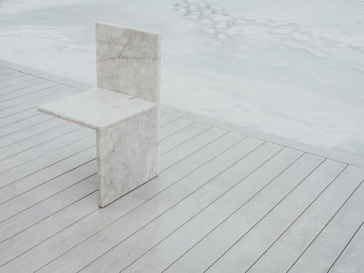 And Here I Sit, a hall chair in bianco quartzite