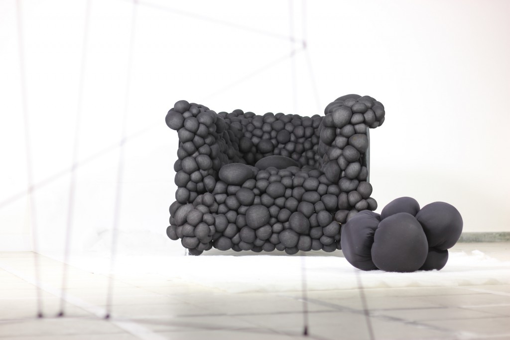 MEHDI KHESSOUANE - BLACK TUMOUR CHAIR The Black Tumour Chair is a comment on humanity's hubris and its quest to build a civilisation at the expense of ecological harmony —with oil spills, nuclear radiation, pollution and coral bleaching.